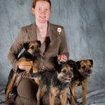 Tegan Whalan with blue border terrier bitches Myrtle, Clover, and Winnie.